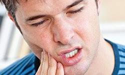 dor no dente da frente
