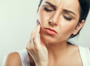 dente siso sintomas